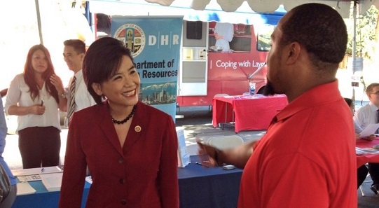 Rep. Chu with a constituent at the 5th Job Hunters Boot Camp