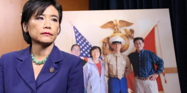 Rep. Chu at a press conference on military hazing, in front of a photo of her nephew Harry Lew.